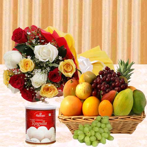 Attractive Bouquet of Roses with Tasty Haldiram Rasgulla and Assorted Fruits Basket
