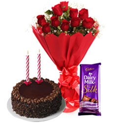Beautiful Selection of Red Roses Bouquet with Silky Cadbury Dairy Milk Silk, Chocolate Cake and Candles for midnight delivery