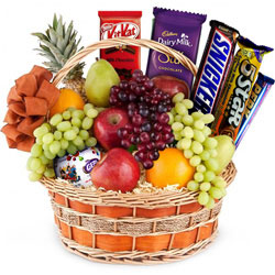 Pleasurable Chocolates with Mixed Fruits in a Basket