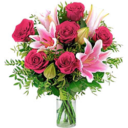 Awesome Lilies with Roses in a Glass Vase