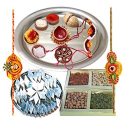 Superb Rakhi Special Presents of Dry Fruits, Classic Silver plated Thali, Delicious Kaju Katli with 2 Free Rakhi, Roli Tika and Chawal